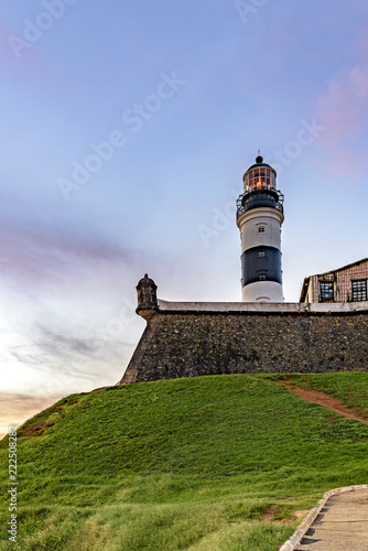 Foto  Tower of the historic and famous Farol da Barra fortification located at All Sai