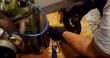 Mechanic servicing mac wheel in garage 4k