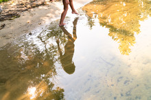 Low Section Of A Girl Wading In The Water