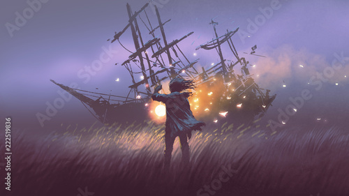 Photo night scenery of a man with magic lantern standing in field looking at shipwreck