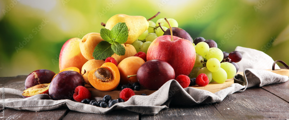 Fototapeta Fresh summer fruits with apple, grapes, berries, pear and apricot