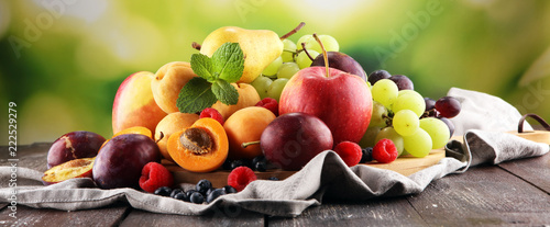 Fresh summer fruits with apple, grapes, berries, pear and apricot - 222529279