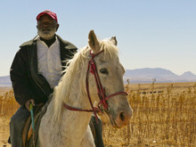 Old Basotho Man On Horse In Th...