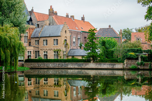 Poster Brugge Old medieval houses near a river, fall season. Bruges, Belgium
