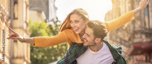 Fototapeta Smiling beautiful couple dating outdoors. obraz