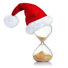 Hourglass With Christmas Santa Hat Showing The Passage Of Time