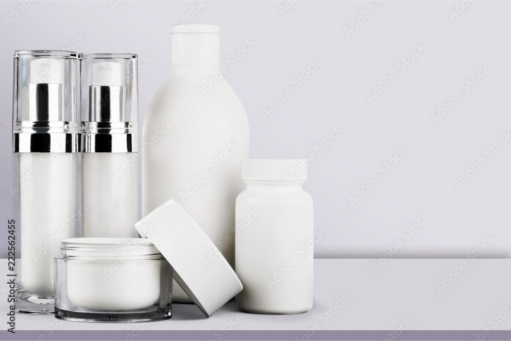 Fototapeta Cosmetic containers isolated on background