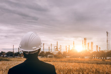 Construction Engineers Control In Safety Suit Work Of Refineries.