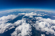 Leinwandbild Motiv Curvature of planet earth. Aerial shot. Blue sky and clouds