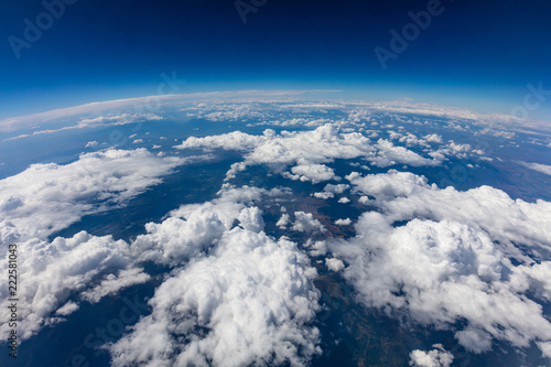 Curvature of planet earth. Aerial shot. Blue sky and clouds - 222581043