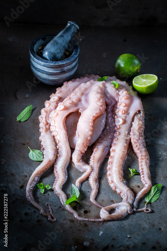 Freshly caught octopus with lime and mint leaves