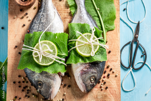 Preparing whole fish with horseradish and lemon