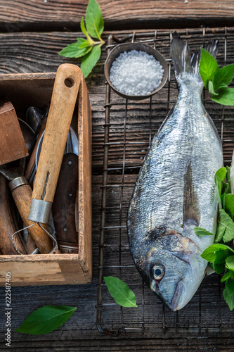 Seasoning freshly caught fish with mint and lemon