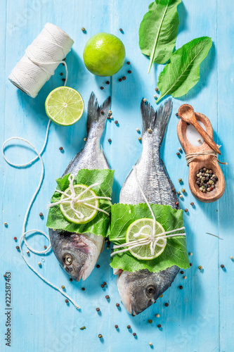 Preparing sea bream with salt and pepper