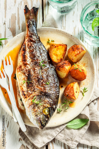 Fresh seabream and potatoes with cherry tomatoes and thyme