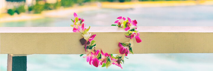 Hawaiian lei flowers necklace panoramic banner for polynesian or hawaiian culture tradition. Panorama background.
