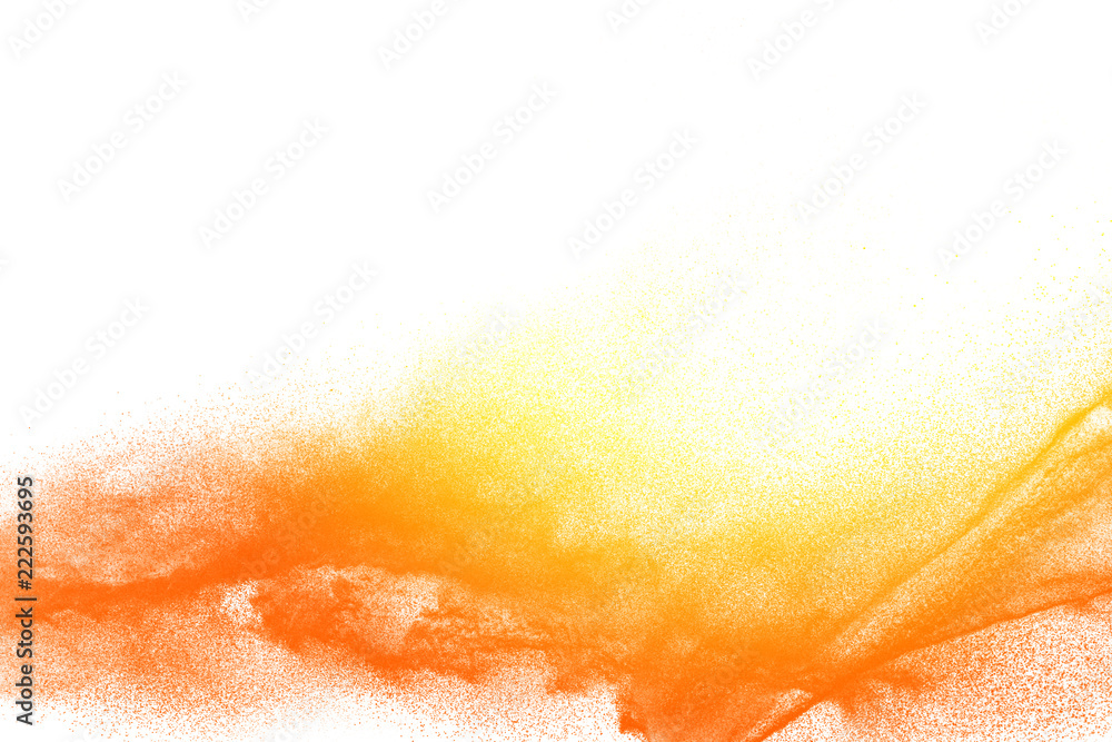 Fototapeta Yellow orange dust particles explosion on white background. Powder dust splash.