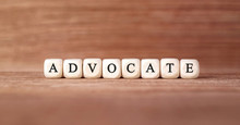 Word ADVOCATE Made With Wood Building Blocks