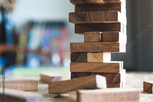 Valokuvatapetti Closeup image of a Jenga or Tumble tower wooden block game