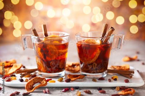 Foto auf Gartenposter Tee Drink with dried fruits and berries