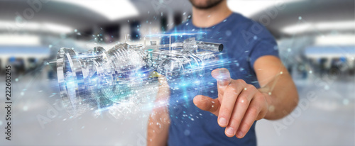 Businessman using wireframe holographic 3D digital projection of an engine