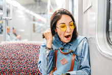 Sleepy Woman Yawn In Train Or Metro, Sleepless And Insomnia Concept