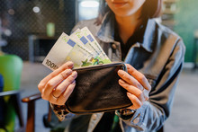 Close Up Of Woman Hands With Wallet And Euro Banknote Money In Cafe