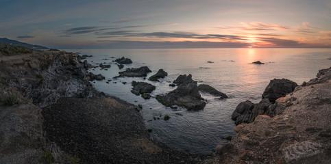 Fototapeta sunset on coast of sea