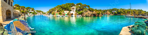 Panoramic view of old fisher village and boats at bay coast of Mallorca island