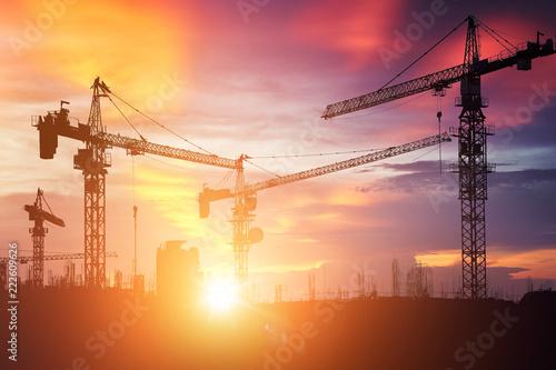 Fotografie, Obraz  Construction cranes and buildings