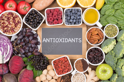 Photo Food sources of natural antioxidants such as fruits, vegetables, nuts and cocoa powder