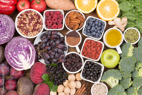 Fototapeta Food sources of natural antioxidants such as fruits, vegetables, nuts and cocoa powder. Antioxidants neutralize free radicals obraz