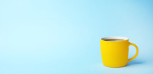 Yellow Ceramic Cup With Hot Ar...