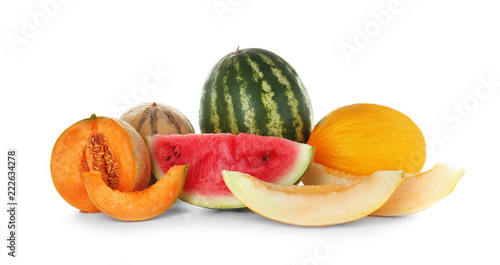 Sliced tasty melons and watermelons on white background