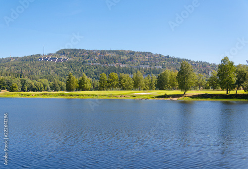 Oslo Bogstad lake in summer with a view of the golf course.