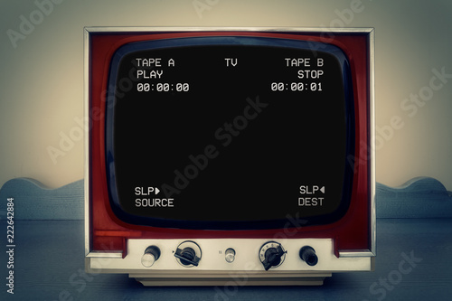 Fotografia, Obraz A retro vintage TV showing a clean black VHS tape screen tracking a signal coming from a double deck