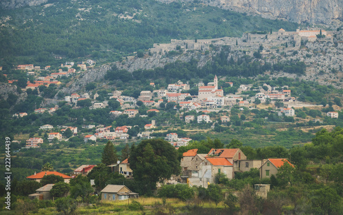 Tuinposter Historisch geb. Fortress of Klis and old village in Croatia.