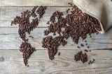 World of Coffee - fresh roasted coffee beans conceptual background