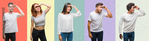 Composition of african american, hispanic and chinese group of people over vintage color background very happy and smiling looking far away with hand over head. Searching concept.