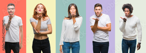 Fotografia Composition of african american, hispanic and chinese group of people over vintage color background looking at the camera blowing a kiss with hand on air being lovely and sexy