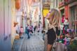 Leinwandbild Motiv Young lady in dress on medieval street of Bremen, Germany. Trevel destination concept