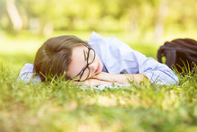 Beautiful Young Woman Fall Sleeping On Fresh Grass In Park