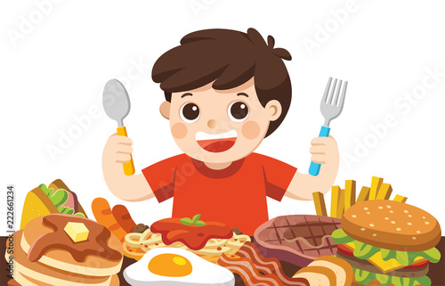 A Boy with spoon and fork going to eat Foods. Fototapeta