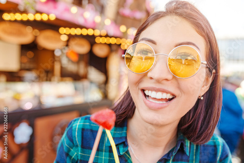 Cheerful Woman Enjoying European Fair Market and festival