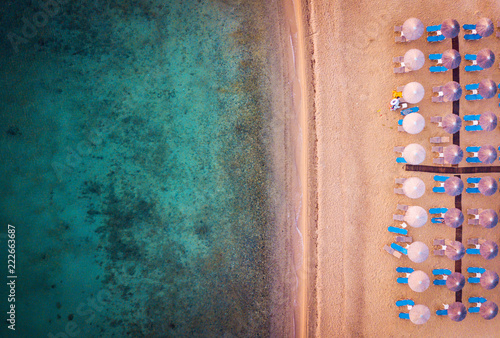 Beach with umbrellas and sunbeds aerial view