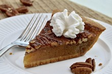 Slice Of Pecan Pie With Whippe...