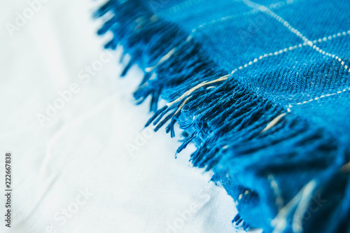 Deurstickers Kristallen Soft, cozy blue blanket on white wooden background. Autumn comfort, space for text, top view flat layer with copy space for slogan or text