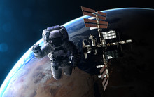 Astronaut And ISS On Backgroun...