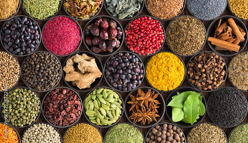 Foto op Aluminium Aromatische colorful spice background, top view. Seasonings and herbs for Indian food