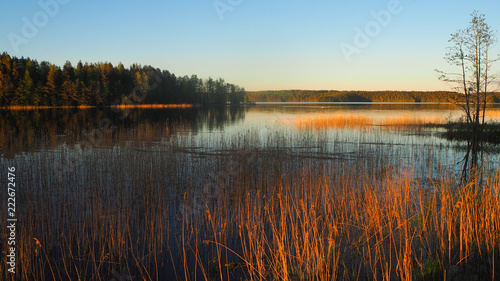 Tuinposter Khaki sunset at saimaa lake in finland